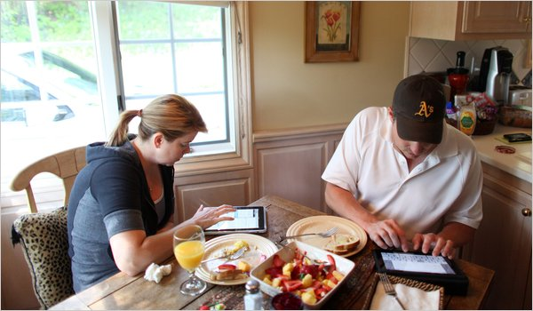 iPads at Breakfast (picture from the source article at NYTimes.com)